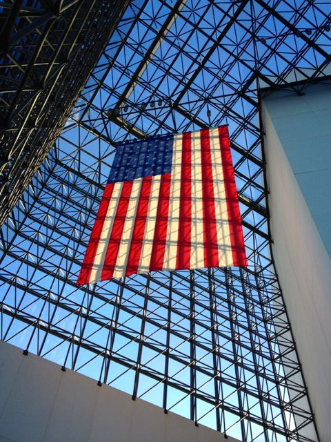 The giant flag hanging from the glass atrium in the JFK Library.