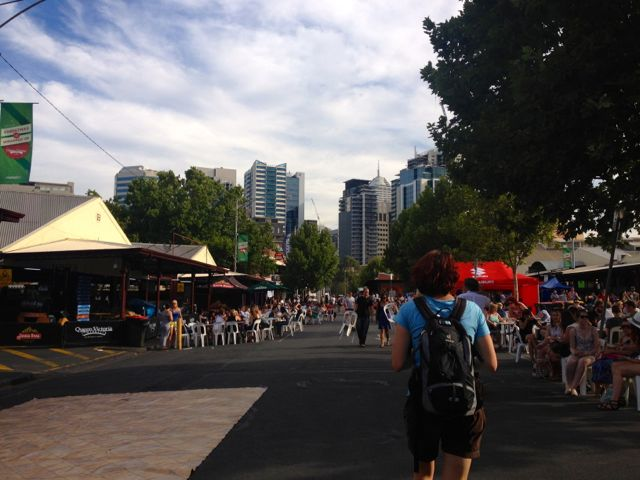 The beginning of the Queen Victoria Markets night time session with market stalls, heaps of bands, lots of food and drinks, and a bzillion people enjoying the summer sun.