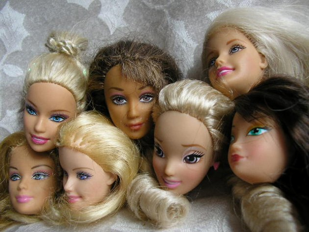 """Set of 7 Barbie and same size doll heads""...I do not like the way that one in the middle is looking at us..."