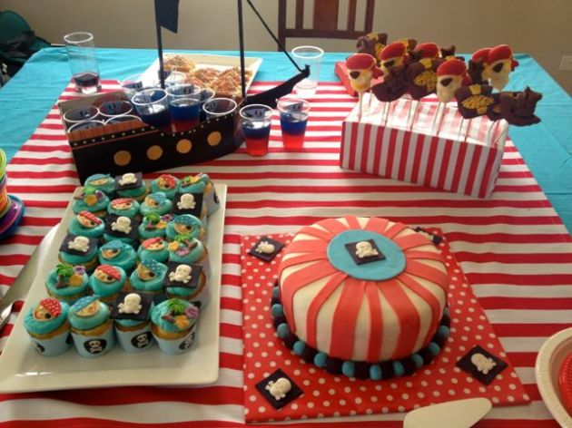 Arrr, there be the cupcakes, jellies (in a pirate ship), chocolates and cake.