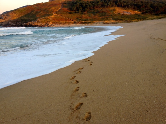 Stepping out at the end of the earth - morning walk on the beach in Finisterre.