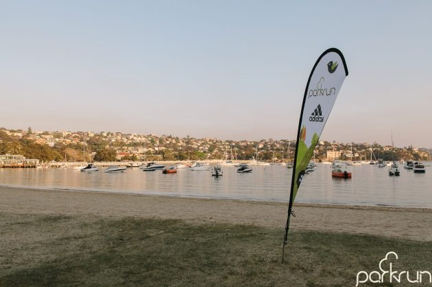 Flagging the end of the run.  [image from Mosman parkrun Facebook page]