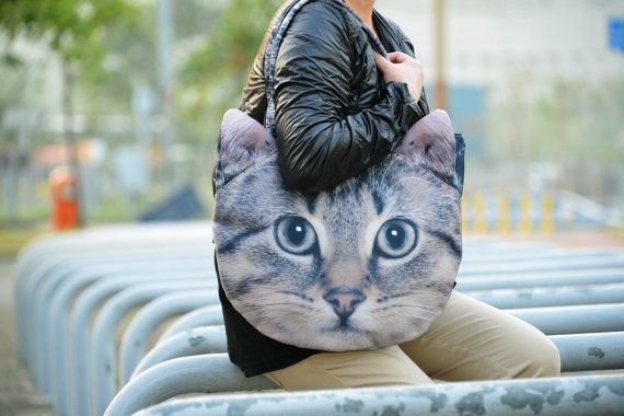 """Brown Cat Bag"" includes cat-like straps.  [image from BENWINEWIN]"