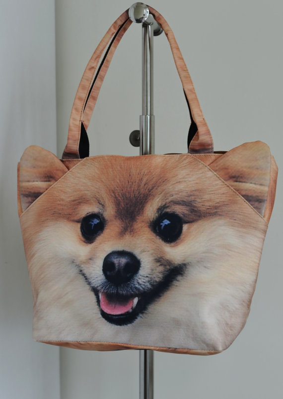 The Pomeranian. Happiest dog-bag in the world. [image from BENWINEWIN]