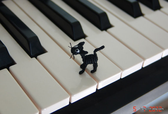 Everyone needs 'Ugly Black Cat' tapping across their piano keys. Or guarding the milk in the fridge.  [image from LamLinh.etsy.com]